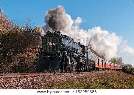 CHANHASSEN MN - OCTOBER 9,2016: The Milwaukee Road #261 steam train on its annual Fall Colors Tour from Minneapolis MN to Winthrop MN. This line has not had regular passenger trains traffic since 1960.