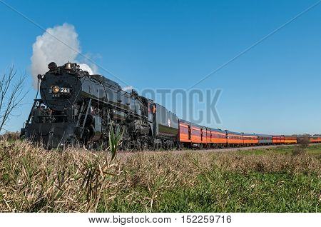 HAMBURG MN - OCTOBER 9,2016: The Milwaukee Road #261 steam train on its annual Fall Colors Tour from Minneapolis MN to Winthrop MN. This line has not had regular passenger trains traffic since 1960.