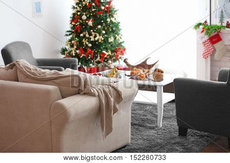 Decorated Christmas room with beautiful fir tree