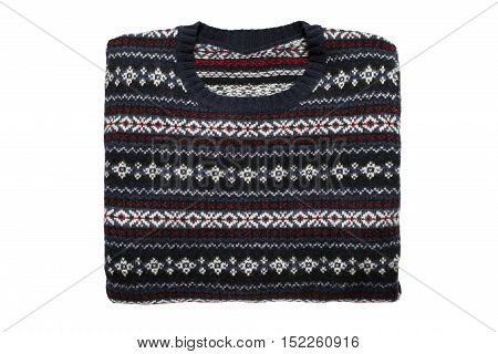 Knitted folded sweater isolated over white background