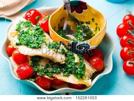 Lazy Fish.fried tilapia fillet with tomato.seletive focus