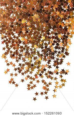 Golden sparkling star dust on white background