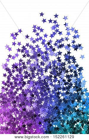 Purple and blue sparkling stars on white background
