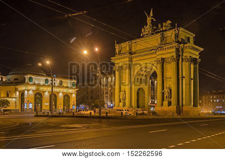 Narva Triumphal Arch in the Narva Square (known as Stachek Square) and Narvskaya subway station (to the left) by night in Saint Petersburg Russia.