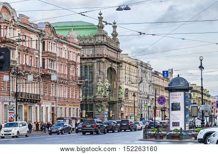 Saint Petersburg Russia - September 25 2016: The view of Nevsky Prospect with its afternoon rush hour traffic as seen from Sadovaya Street with Elisseeff Emporium a famous food hall one of the most striking examples of Art Nouveau style in a typical rainy