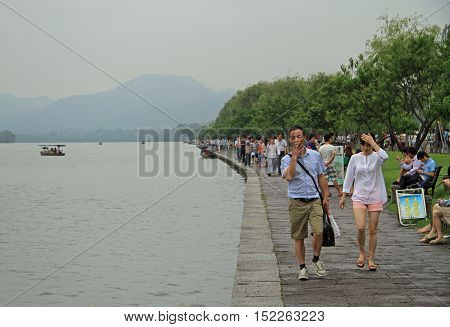 People Are Walking Along The Embankment