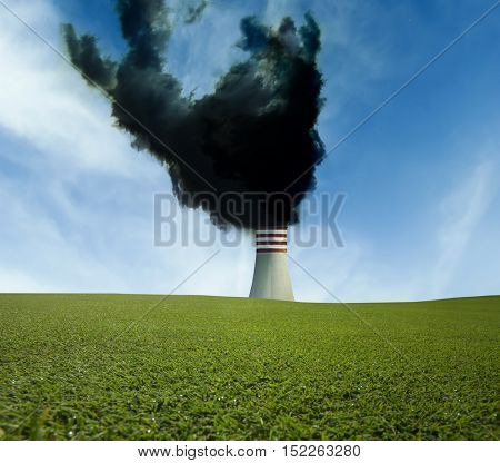 Industrial chimney with black smoke  and the green field