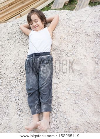 Kid in sand