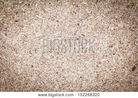 Chipboard texture or chipboard background. Empty bulletin chipboard for design with copy space for text or image. Dark edged.