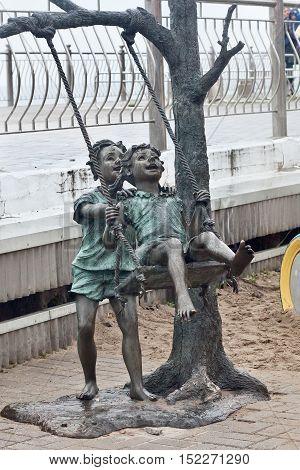 RUSSIA ZELENOGRADSK - OCTOBER 11 2014: Sculpture of children playing in the Zelenogradsk promenade. Zelenogradsk (Cranz) is a resort town in Kaliningrad Oblast Russia near the Curonian Spit on the Baltic Sea.