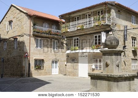 CAMBADOS, SPAIN - AUGUST 8, 2016: Restaurant in typical stone house in Cambados a town of the province of Pontevedra in Galicia Spain.
