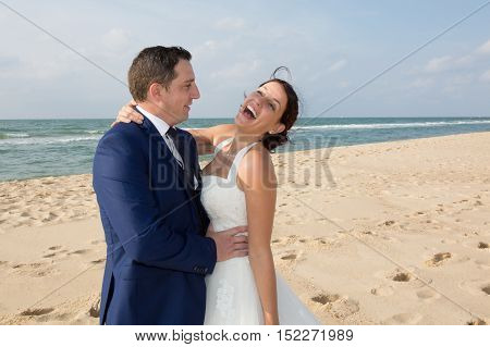 Portrait Of A Smiling Couple Sharing A Romantic Time At The Beach