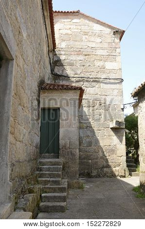 Traditional stone houses in alley in Cambados a town of the province of Pontevedra in Galicia Spain.