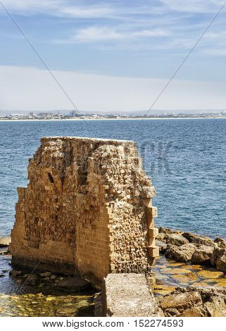 A fragment of a ruined fortress wall of the ancient city Akko.Izrail the Mediterranean Sea.