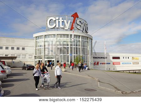 Trondheim, Norway - May 25, 2013: The Mall City South with customers that come with shopping cart in the car park outside the entrance.