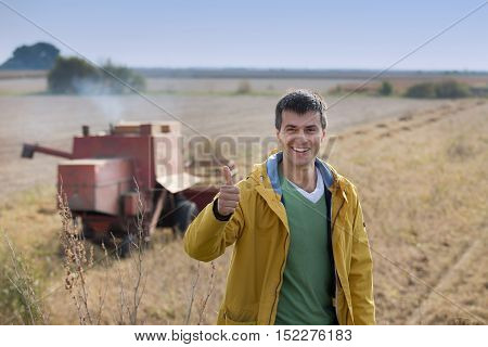 Farmer Showing Thumb Up At Soybean Harvest