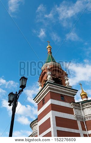 Orthodox Christian church with gold domes rises upwards