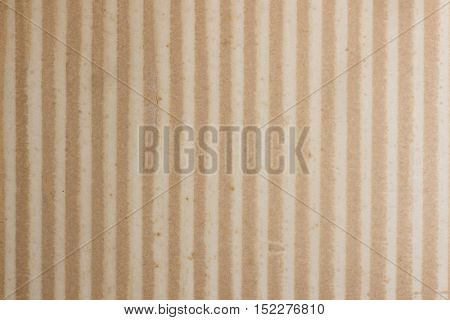 Vintage stripe pattern texture. Amber tone paper with stripes and stain.