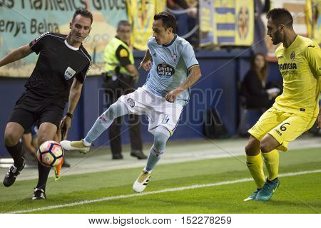 VILLARREAL, SPAIN - OCTOBER 16th: 14 Orellana, 6 Victor Ruiz during La Liga soccer match between Villarreal CF and R.C. Celta de Vigo at El Madrigal Stadium on October 16, 2016 in Villarreal, Spain