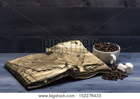 Cup Of Coffee Beans, Marshmallows And Book