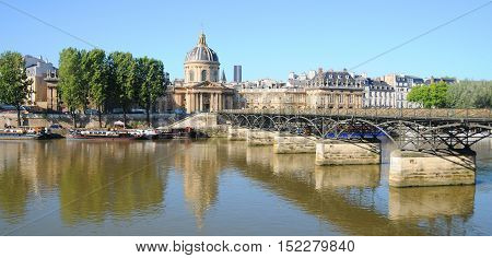 PARIS FRANCE MAY 22 12: Historic bridge (Pont Alexandre III) over the River Seine and the Grand Palais (Great Palace) is a large historic site, exhibition hall and museum located at the Champs-Elysees