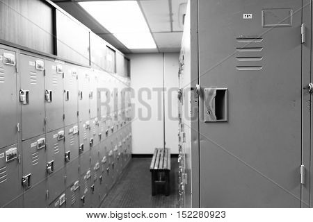 Close up lockers in gym school and plant in black and white tone.
