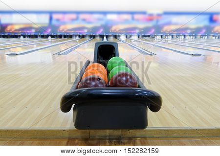Close up of colorful bowling ball lying on the house ball