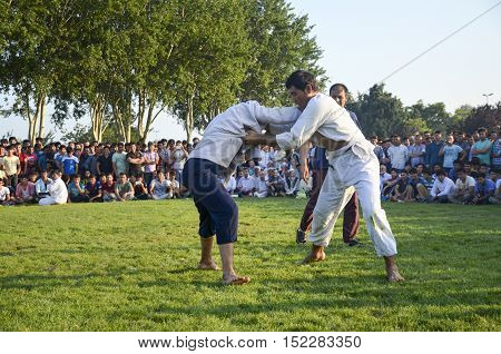 Istanbul Turkey - July 31 2016: Central Asian Turkmen wrestling. in Zeytinburnu district of Istanbul Turkmen wrestling sports events held in the coastal meadows. Turkmen Uzbek Afghan Turkish Turkmenistan Kazakhstan Turkey and other Central Asian youth