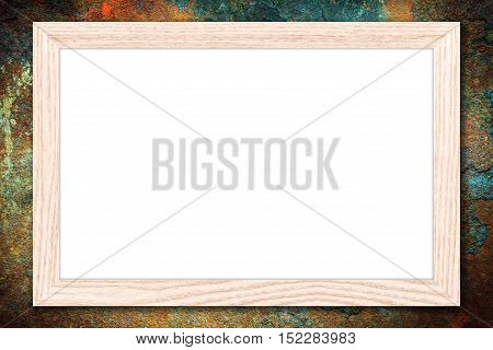 Whiteboard or Empty bulletin board with a wooden frame on rusty metal background with copy space for text or image.