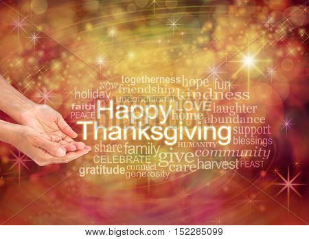 Have a Happy Thanksgiving - female cupped hands with the word THANKSGIVING to the right surrounded by a word cloud on a warm golden orange sparkling starry celebration background
