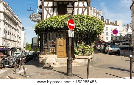 Paris France-July 09 2016: The traditionnal French restaurant Le Basilic located in picturesque Montmartre district of Paris.
