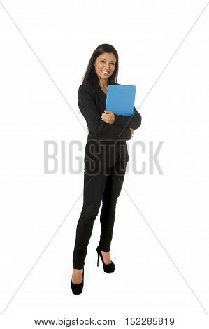 corporate portrait young attractive latin businesswoman in formal office suit smiling happy holding folder standing isolated on white background in business project presentation in success concept