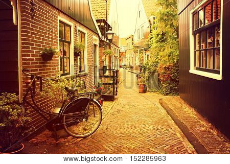 Netherlands. Volendam. Narrow old street in the picturesque fishing village at sunset