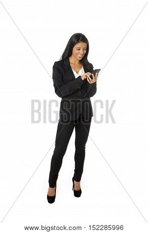corporate portrait young attractive latin businesswoman in formal office suit smiling happy networking on mobile phone isolated on white background in business project presentation in success concept