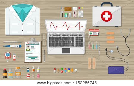 Wooden doctors desk with laptop medical and healthcare devices and pills. vector illustration in flat style
