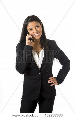 corporate portrait young attractive latin businesswoman in formal office suit smiling happy talking on mobile phone isolated on white background in business project presentation in success concept