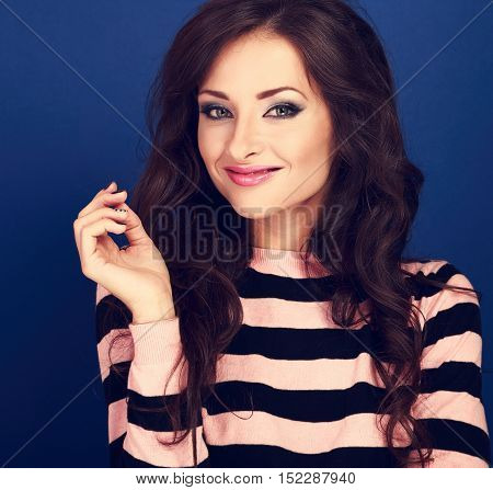 Beautiful Smiling Woman With Hand Near Face With Curly Long Hair On Blue Background. Closeup Happy P