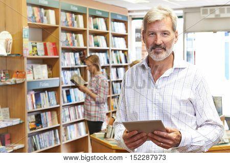 Portrait Of Male Booshop Owner Using Digital Tablet