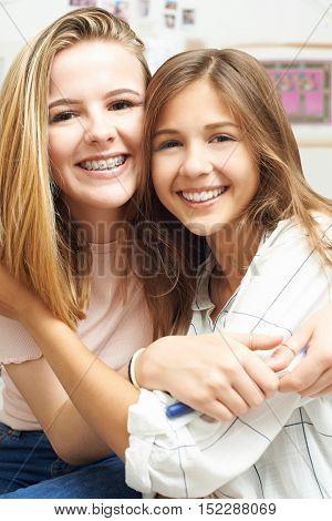 Portrait Of Two Female Teenage Friends In Bedroom