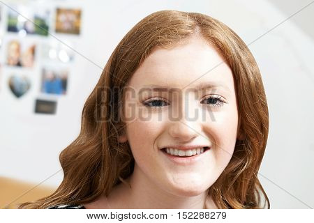 Portrait Of Smiling Teenage Girl At Home