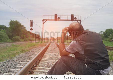 Men who despair Sitting on railroad tracks