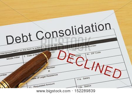 Applying for a Debt Consolidation Loan Declined Debt Consolidation Loan application form with a pen on a desk with an declined stamp