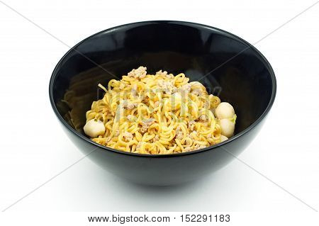 Yellow instant noodle in black bowl on white background