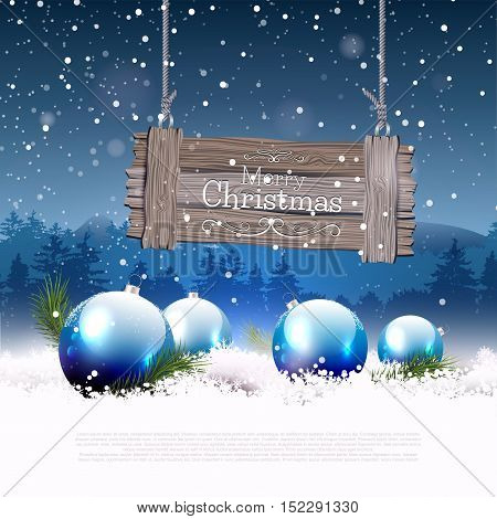 Christmas greeting card with blue baubles in the snow and wooden sign