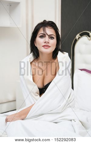Woman  Smiling  In A Blanket