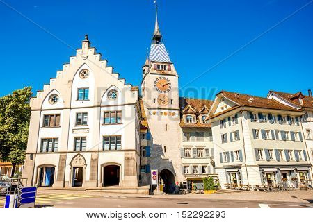 View on the city gate and clock tower in Zug town near Zurich city in Switzerland