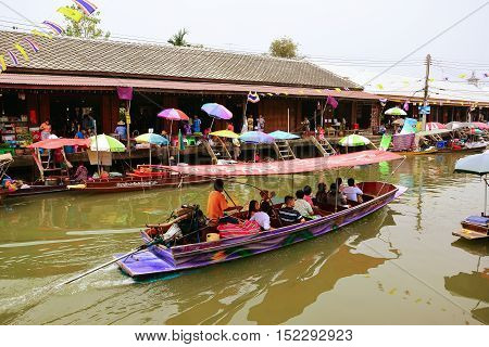 BANGKOK THAILAND - APRIL 2014:wooden boats busy ferrying people at Amphawa floating market on April 22 2014 in Bangkok. traditional popular method of buying and selling