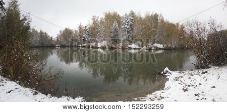 Pond in a forest in winter. Panoramic image from several pictures.