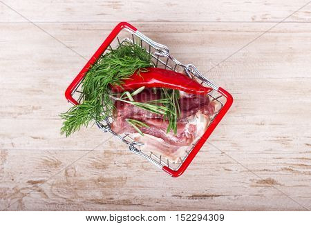 Appetizing breasts with aromatic spices in the shopping cart