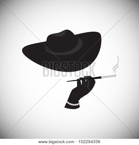 The strange lady in a hat holding a cigarette in the mouthpiece. A woman in a mafia style.
